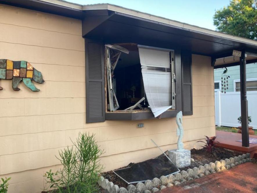 A broken window in a house.