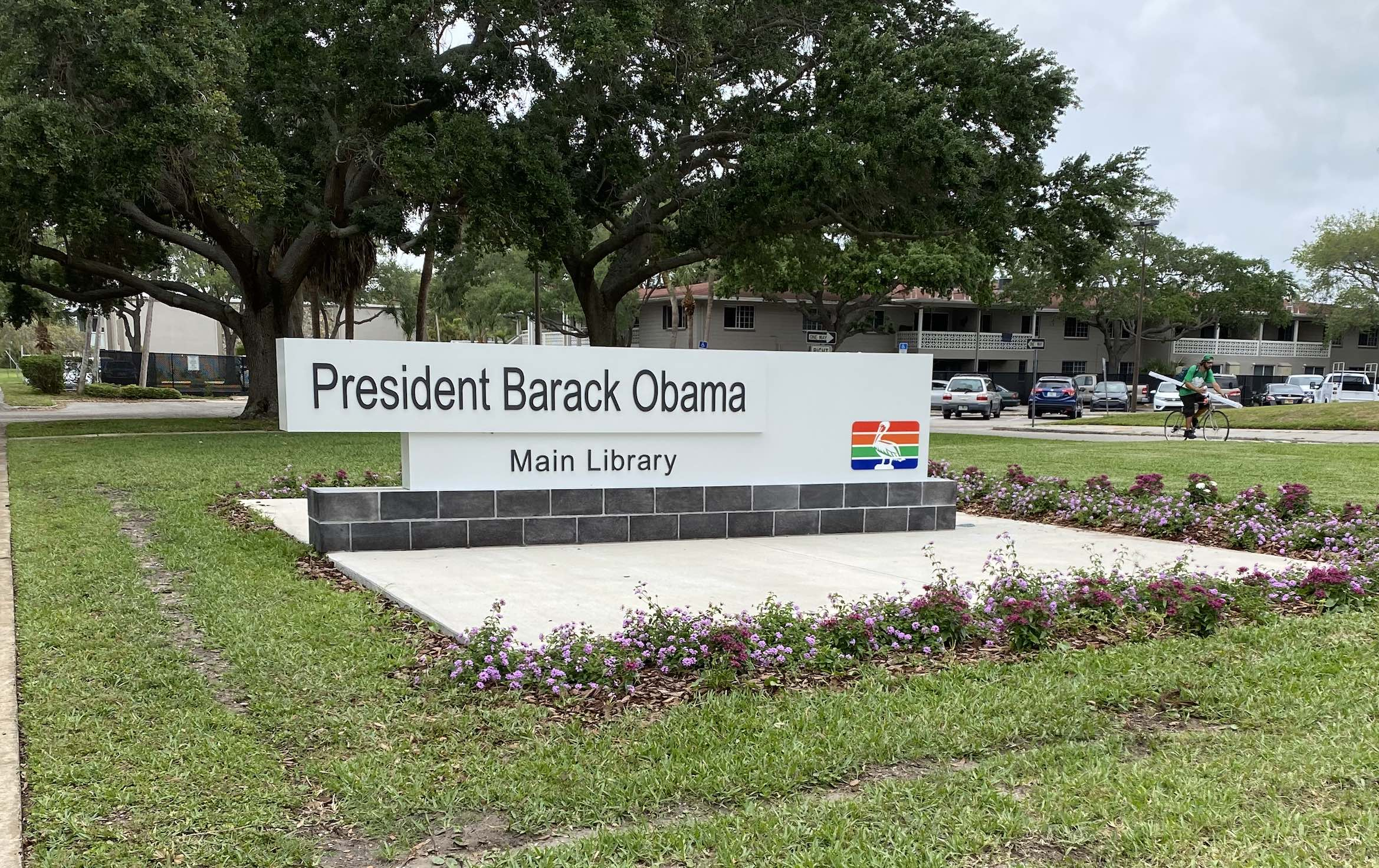 A photo of a sign in the grass for the President Barack Obama Library in St. Petersburg Florida.