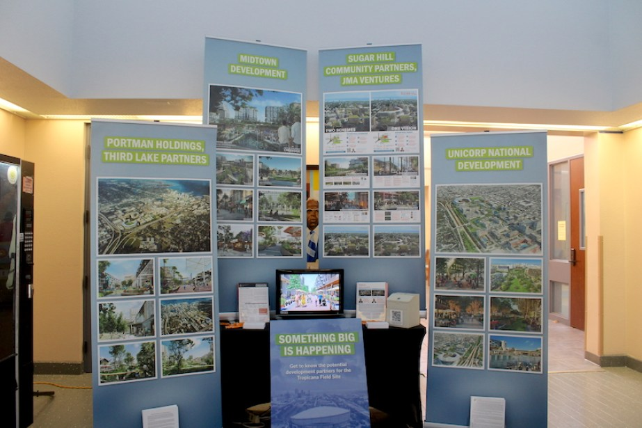 Four pasteboard signs in a lobby advertising the Tropicana Redevelopment Site Plans in St. Petersburg Florida