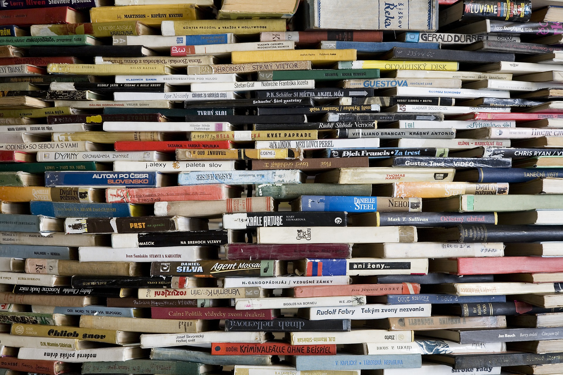 A huge stack of many different kinds of books