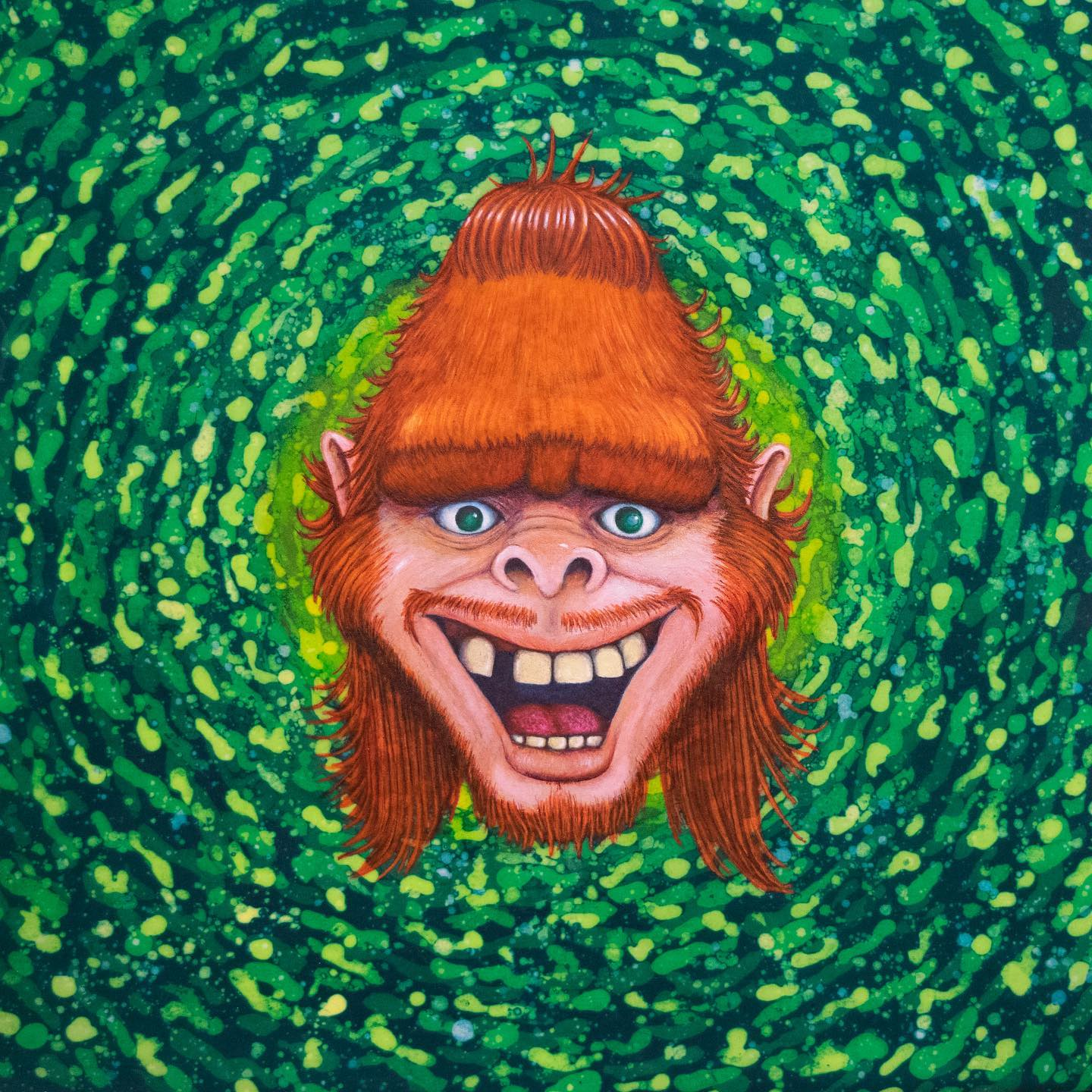 An artwork of a monkey-like face with a beanie hat in a field of swirling green color