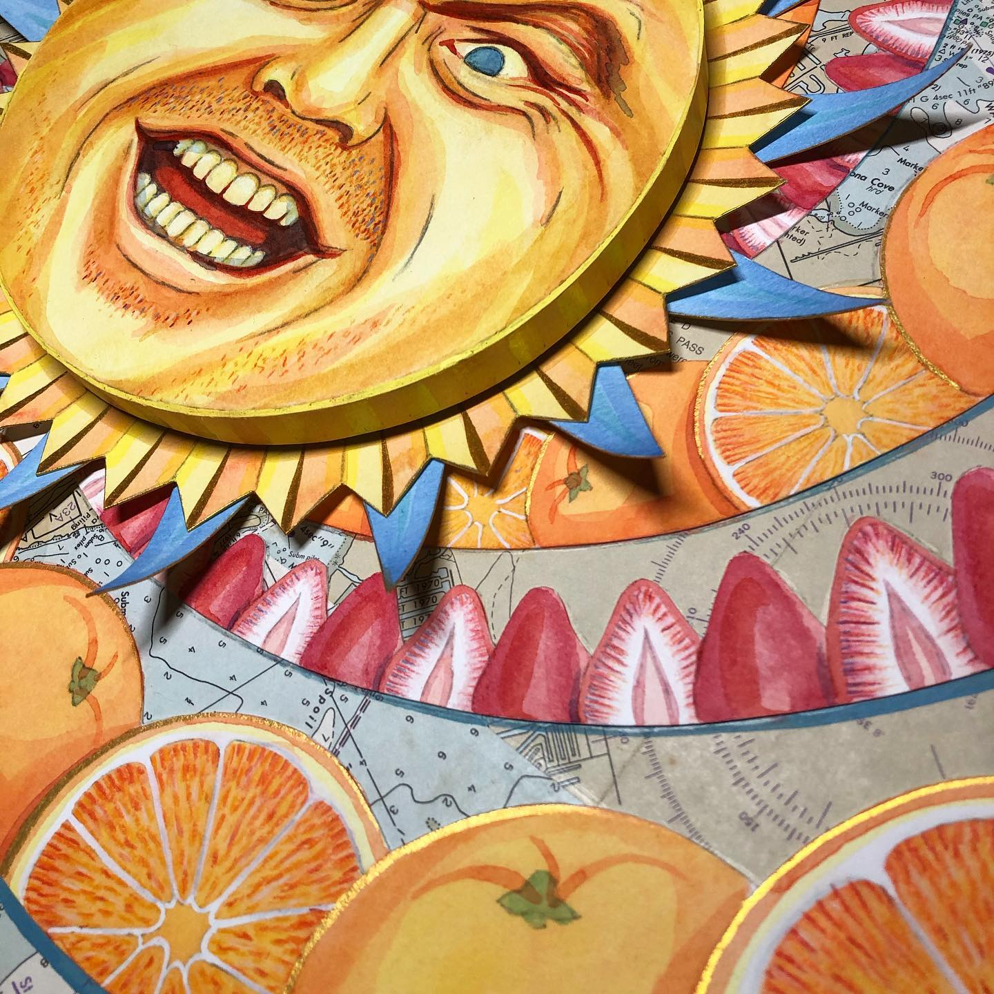 A colorful piece of art showing an angry sun face in the middle of swirls of oranges and strawberries.
