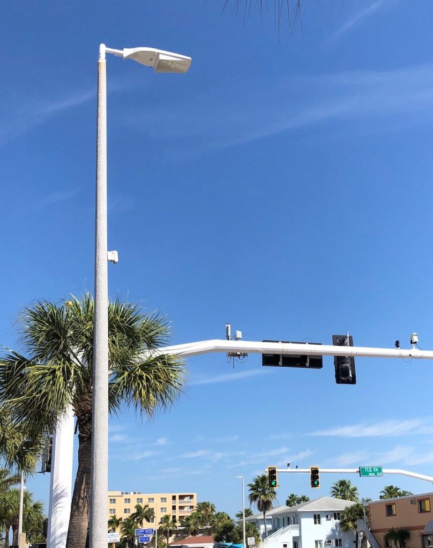 A photo of a streetlight with a blue sky background