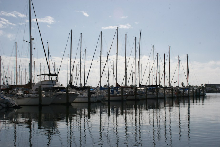 A photo of boats in a marina at sunset.