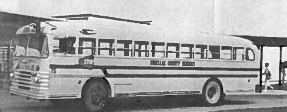 An old black and white photo of a school bus.