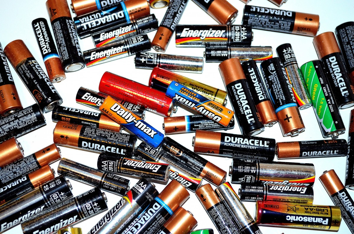 Batteries stacked up on white background