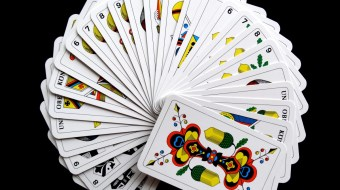 Cards fanned out on black background
