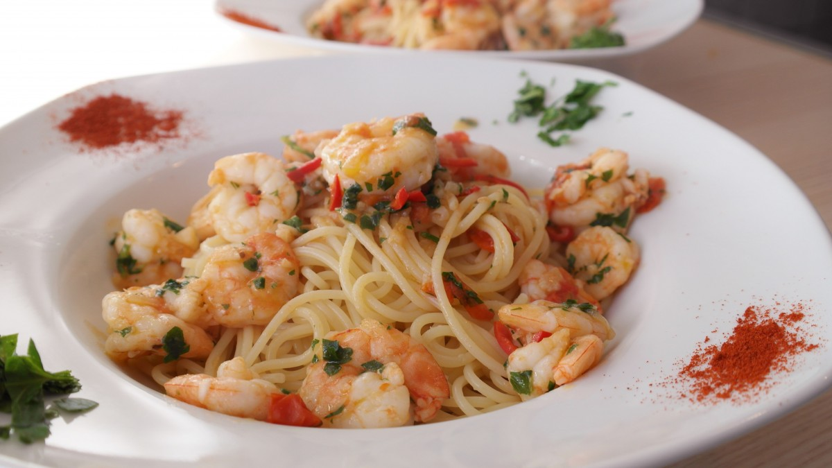 Pasta with shrimp in a white bowl