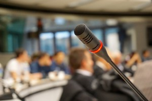 Microphone in a crowded room of people.