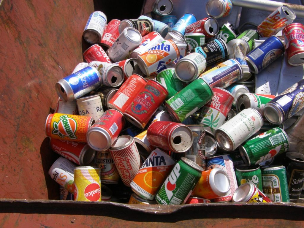 Trash, mainly cans, stacked in a pile
