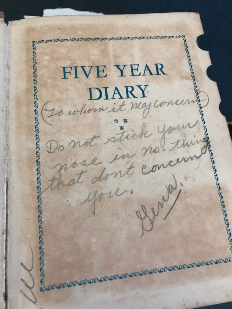 """A photo of an old, yellowed diary with the words """"Five Year Diary"""" printed in blue with a decorative blue border and pencil handwriting that reads """"To Whom It May Concern: Do not stick your nose in no-thing that don't concern you. Gena"""""""