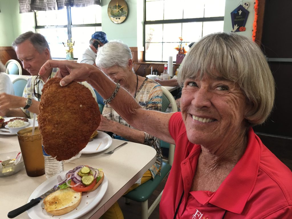OLLI student Bonnie Rickus shows off a sizable lunch during one of OLLI's pre-pandemic field trips.