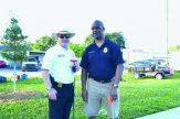 Gulfport and St. Petersburg Police Chiefs Vincent, left, and Holloway prepare for trash picking.