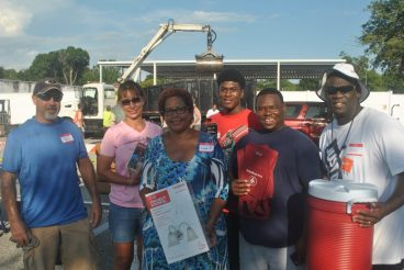 Volunteers battled sweltering heat and thunderstorms to help make the event a success. From left: John Della, of Gulfport, Tina Della, of Gulfport, Councilwoman Yolanda Roman, Darius Howard, of St. Petersburg, Gabriel Dilworth, of St. Petersburg, and Mike Culbreth, of Gulfport