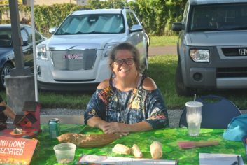 Juju Stevens, along with Lisa Blackstock of the Gulfport Gecko Garden, beat the heat under their tent sharing gardening tips and information about Vermiculture Technology.