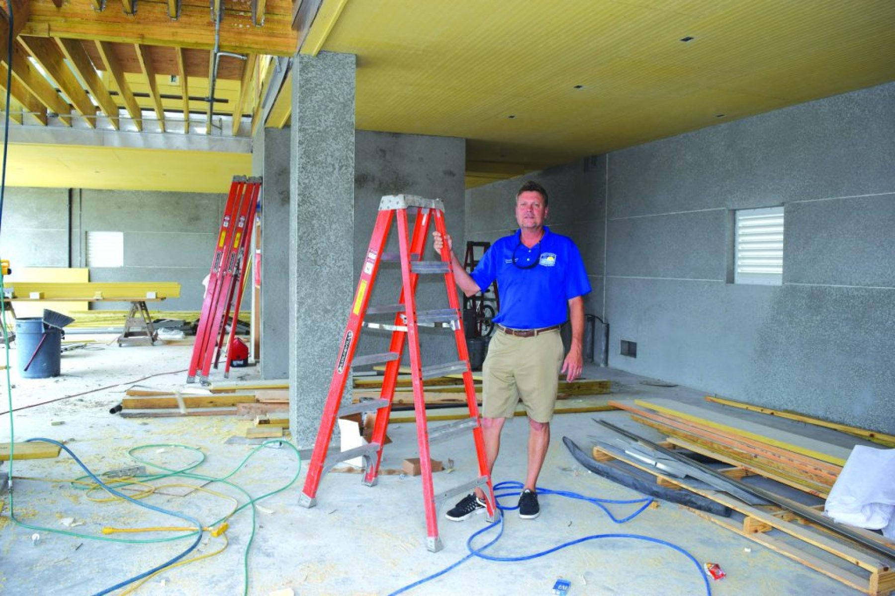 Gulfport Marina Harbormaster Denis Frain poses on the first floor of the new facility, which will serve as a waiting area for charter-boat patrons.