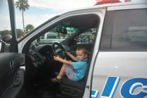Ethan Ouimette, 3, sits casually in a Gulfport Police car. In the front seat, of course.