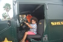 Damonii Woods, 3, wears his Easter best in a police Humvee at the Gulfport Fun in the Sun day on Saturday, March 26.