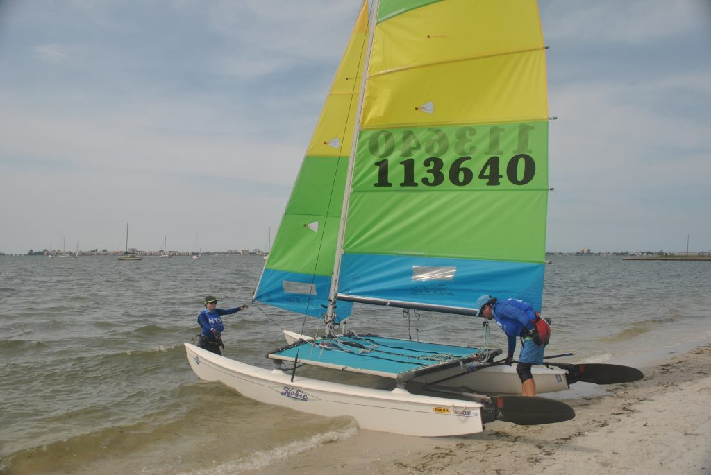 Steve and Dalaney Caron set up their Hobie catamaran before entering the waters of Boca Ciega Bay during the Gulfport Yacht Club's Multi-Hull Regatta on April 30. They came from Daytona to participate. Dalaney also attends and sails at the University of South Florida in St. Petersburg.