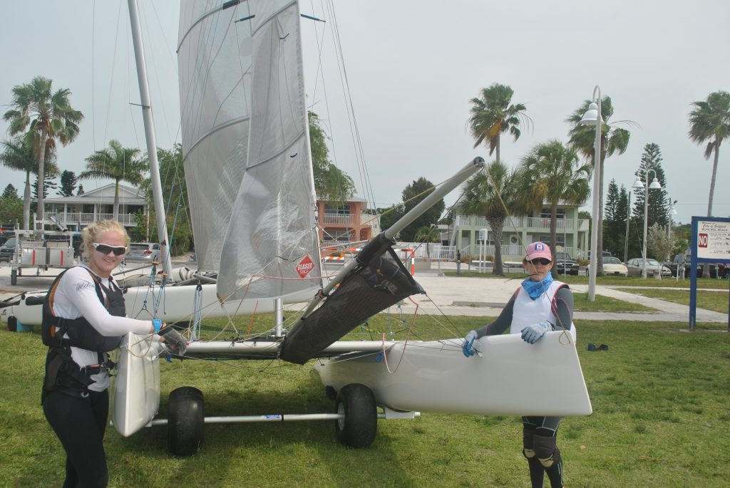 """Lillian Meyers and Sandra Tartaglino get ready to bring their F16 catamaran into Boca Ciega Bay to compete in this year's regatta. """"It's a local regatta,"""" Meyers said when asked why she came from Sarasota to participate. Meyers also describes her boat as """"really fast,"""" which must be true because they came in third place in their class."""