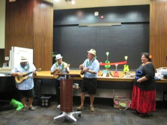 "Tampa Bay Ukulele Society members performed a lively rendition of ""Strumming My Cares Away,""  then Cheryl Morales, executive director of the Pinellas Public Library Cooperative, cut the ribbon and thanked everyone who made the Ukulele Lending Library program possible in Hawaiian."