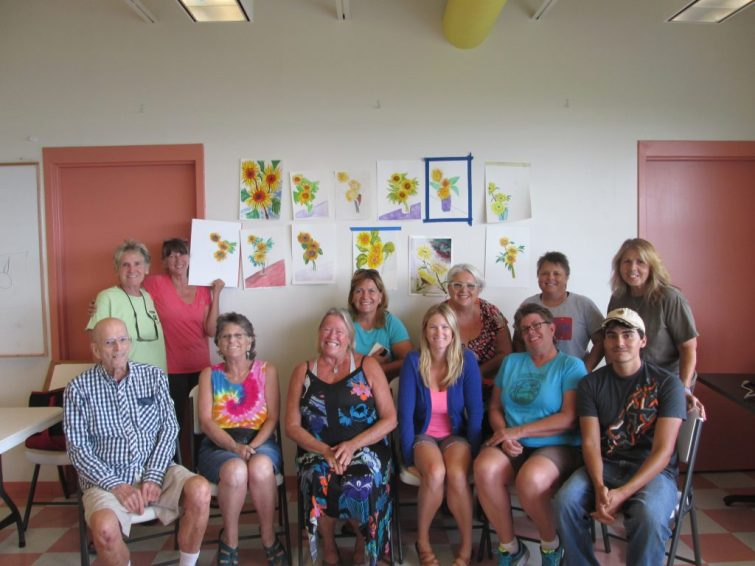 The Watercolors with Patsi class at the Gulfport Recreation Center show off their paintings.