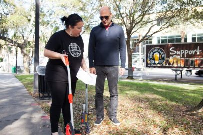 Olga Bof and Jorge Vidal of Keep Saint Petersburg Local work on marking the grounds the day before Localtopia, the 2nd annual event to promote community and independent business awareness.