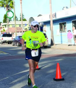 """""""I've got more crap wrong with me than you can shake a stick at, but I still keep running,"""" Mike Calamari said after he crossed the finish line ."""