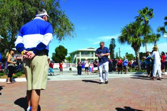 Gulfport Mayor Sam Henderson strolls on the new brick pavers of the beach parking lot before council cut the ribbon on the newly opened project. Photo by Phil Penrose