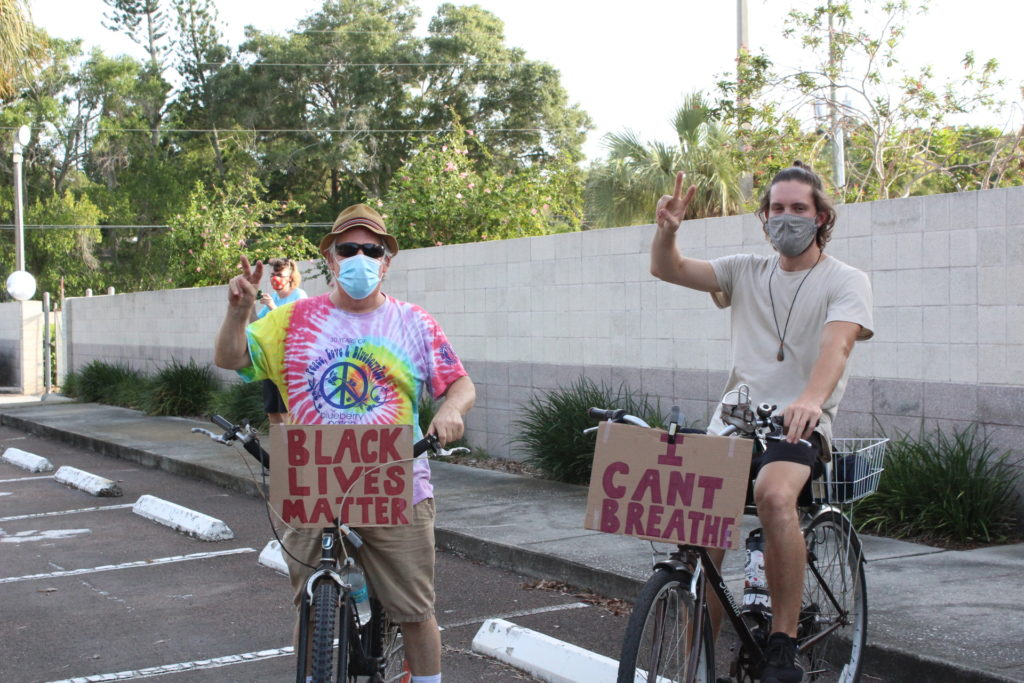 Gulfport residents joined Monday, June 8 rally on foot, bike and in vehicles. Bicyclists rode in front and behind the walkers to ensure the safety of participants and help direct traffic on smaller roads.