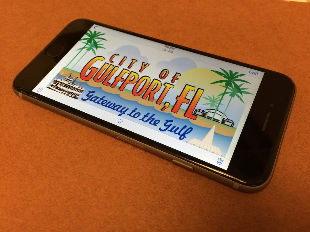 "A photo of an iPhone with the ""City of Gulfport, FL Gateway to the Gulf"" graphic on the screen"