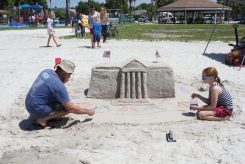 Tom and Josie Pitzen create a sand sculpture of the White House.
