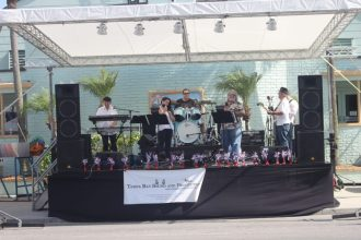 The band entertains the crowd in front of the Casino.