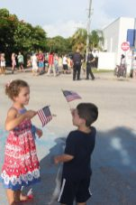 Noah and Isabella Goulet show their patriotism while waiting for the parade to start.
