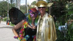 M.J. Price, left, and her husband Marcus Price of Zephyrhills stop to pose for a photo in their colorful costumes.