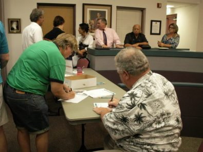 At a public meeting Monday, September 14, Gulfport residents fill out comment forms that city officials say they will evaluate while revising the controversial plan for the Osgood Point Trail