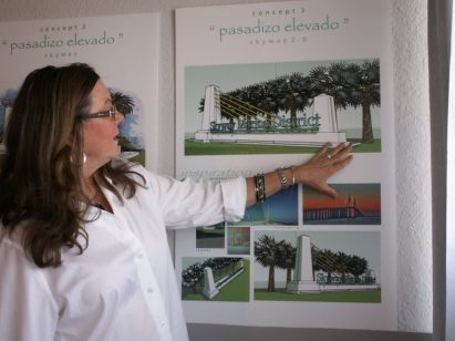 Linda Bowler, manager of the Skyway Marina District team, points out various aspects of the design for the three gateway signs to the district expected to be installed before the end of the year.