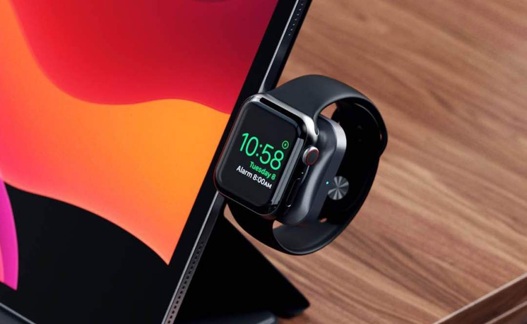 The magnetic charging dock is plugged into an iPad with an Apple Watch on it.