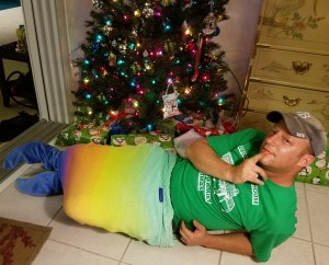 Merman Mike relaxing in front of Christmas tree