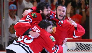 From left to right, the Blackhawks' Corey Crawford, Andrew Shaw and Jonathan Toews celebrated after winning the Stanley Cup.