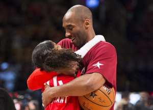 Los Angeles Lakers' Kobe Bryant (24) kisses his daughter before the first half of the NBA all-star basketball game, Sunday, Feb. 14, 2016 in Toronto. (Mark Blinch/The Canadian Press via AP)