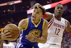 Houston Rockets center Dwight Howard (12) fouls Golden State Warriors guard Stephen Curry (30) during the first half in Game 3 of the NBA basketball Western Conference finals Saturday, May 23, 2015, in Houston. (AP Photo/David J. Phillip)