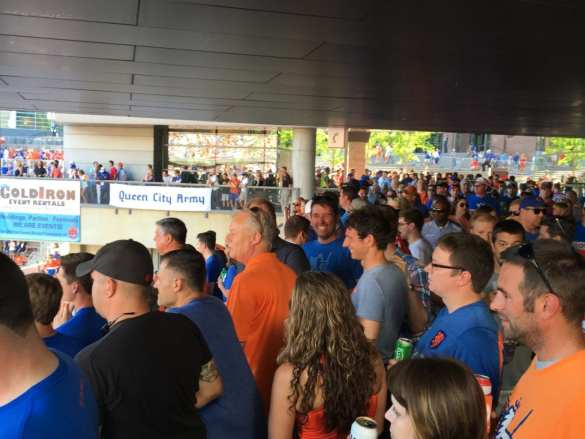"""Fans standing four deep behind """"The Bailey"""" before kickoff."""