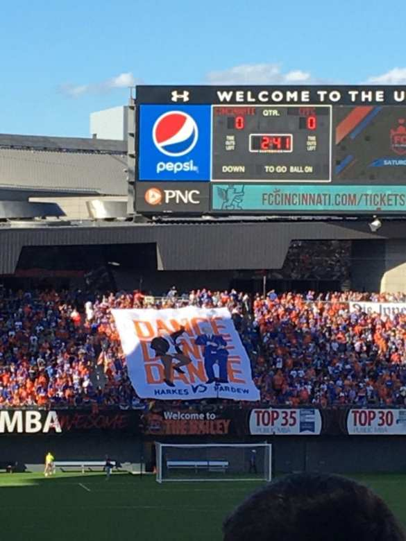 """Supporters groups in """"The Bailey"""" unveil a John Harkes and Alan Pardew banner right before kickoff."""