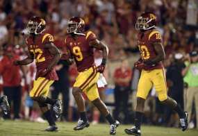Oct 24, 2015; Los Angeles, CA, USA; Southern California Trojans wide receiver JuJu Smith-Schuster (9) runs back toward the sideline after scoring a touchdown during the fourth quarter against the Utah Utes at Los Angeles Memorial Coliseum. The Southern California Trojans won 42-24. Mandatory Credit: Kelvin Kuo-USA TODAY Sports
