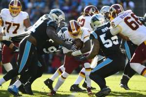 Haskins gets roughed up in Redskins win over Panthers.