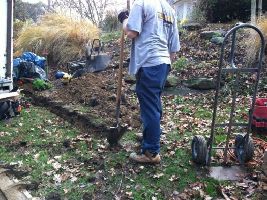 Trenching out for the electrical conduit