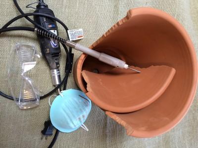Gather materials-dremel, goggles, face mask, pot, carbide tip