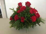 Red roses and boxwood by Monkton Garden Club