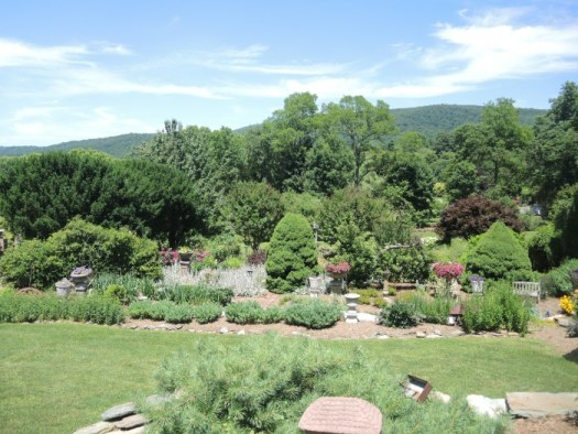 S view of a garden border with the Blue Ridge mountains in the distance